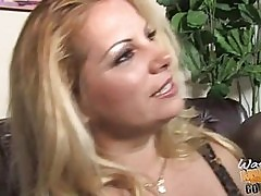Busty blonde plays with two black dicks while her hubby watc...