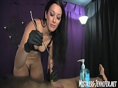 Captive male has cock bitten by Mistress January Seraph